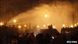 Riot police use water cannons to disperse anti-government demonstrators in downtown Cairo