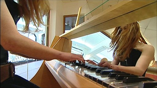 Designer Sarah Davenport plays the world's only rocking piano