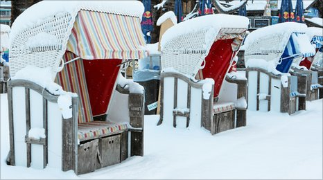 Snow-covered chairs