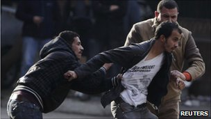 Police arrest protester in Cairo