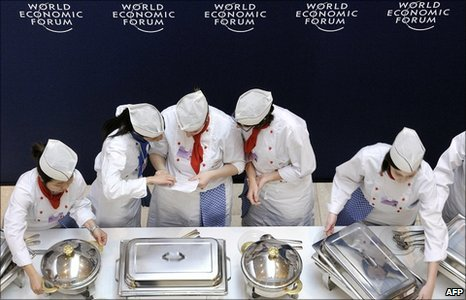 Cooks prepare food on the opening day of the World Economic Forum (WEF) annual meeting in Davos, 26 January.