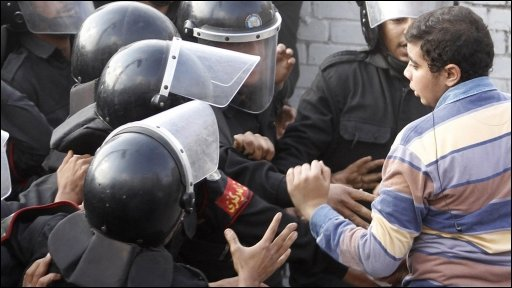 Cairo police push protestor back