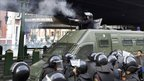 A riot policeman fires rubber bullets in central Cairo