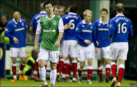 Rangers celebrate after Richie Towell's poor back pass