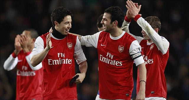 Arsenal celebrate their victory over Ipswich