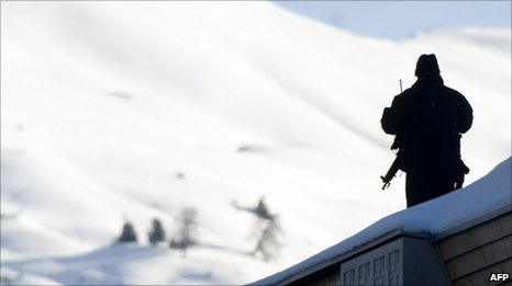 A sniper stands on the roof of the Kongress Hotel close to the Congress Center during the World Economic Forum annual meeting on January 27, 2011 in Davos