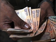 A man counting rupee notes