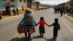 People from the Andean community of Ocongate district in the highlands of Cusco walk along the Interoceanic highway section linking Peru and Brazil in the Andean region of Cusco August 19, 2010