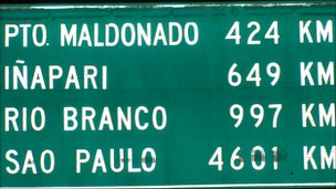 Road sign showing distances from Cusco