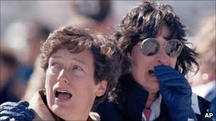 Onlookers watch in horror as the Challenger shuttle explodes