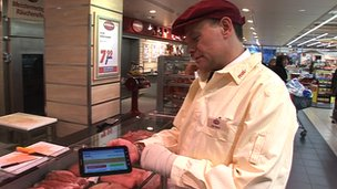 Butcher holding a tablet computer