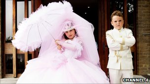 Girls in pink dress and boy in cream suit