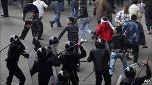 Egyptian protesters flee as riot police charge towards them in Cairo. Photo: 28 January 2011