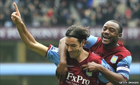 Robert Pires celebrates his first goal for Aston Villa