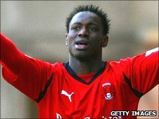 Orient's Paul-Jose M'Poku celebrates after his cross leads to a Swansea own goal