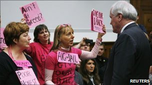 AIG CEO Edward Liddy faced by protesters
