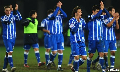Brighton's players salute their travelling fans