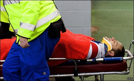 Mark McLaughlin leaves the New Douglas Park pitch on a stretcher