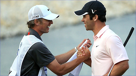 Casey celebrates with caddie Christian Donald