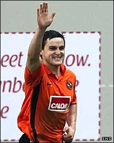Craig Conway celebrates scoring for United