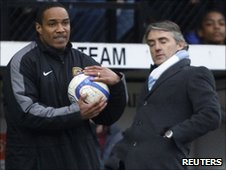 Paul Ince (left) and City boss Roberto Mancini
