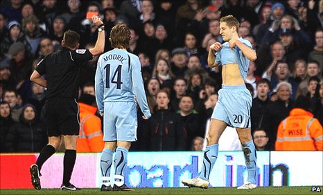Michael Dawson (right) is shown the red card by referee Phil Dowd