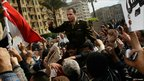 An Egyptian Army officer sympathising with protesters is carried by a crowd in Cairo. Photo: 30 January 2011