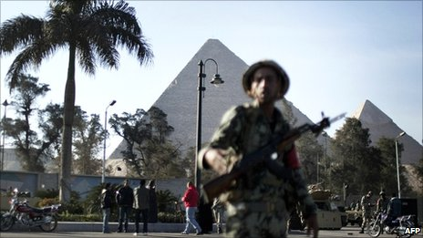 Egyptian army soldiers take position in front of the Giza pyramids