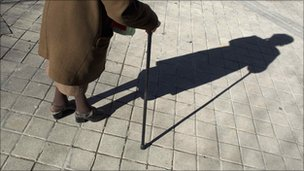 Elderly woman and shadow