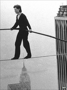 Philippe Petit tightropes between the Twin Towers in 1974