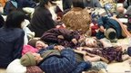 Residents take a rest at a gymnasium acting as evacuation centre in Takaharu town, Miyazaki prefecture