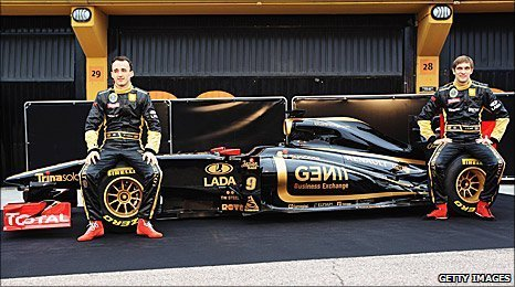 Robert Kubica and Vitaly Petrov pose with the new Renault R31