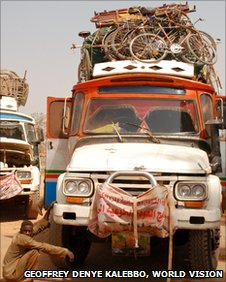 Southern Sudan: Truck carries belongings from the north to the south