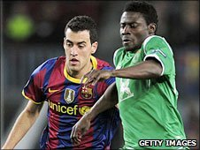 Obafemi Martins (right) in action against Barcelona in the Champions League