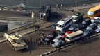 A tank blocks a road over the Nile in Cairo, Egypt - 31 Jan 2011