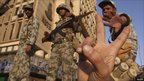 A protester makes a victory sign in front of soldiers in Cairo, Egypt - 31 Jan 2011