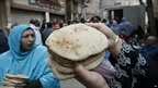 People queue to buy bread in central Cairo - 31 January 2011