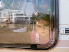 Gypsy child inside a caravan