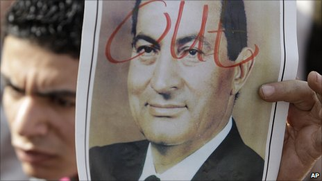 Protester holds photo of Hosni Mubarak with &#039;out&#039; written across it