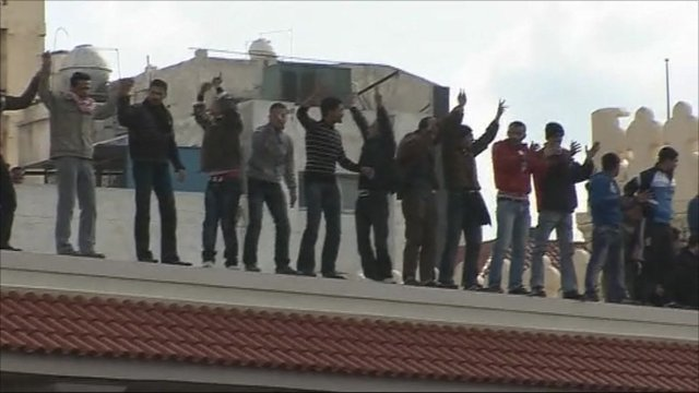 Protesters on roof in Alexandria