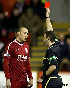 Aberdeen's Andrew Considine is sent off by Alan Muir