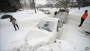 A car stuck in a snowbank is towed away in Hartford, Connecticut - 1 February 2011