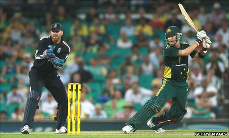 Michael Clarke (right) hits out as Matt Prior looks on