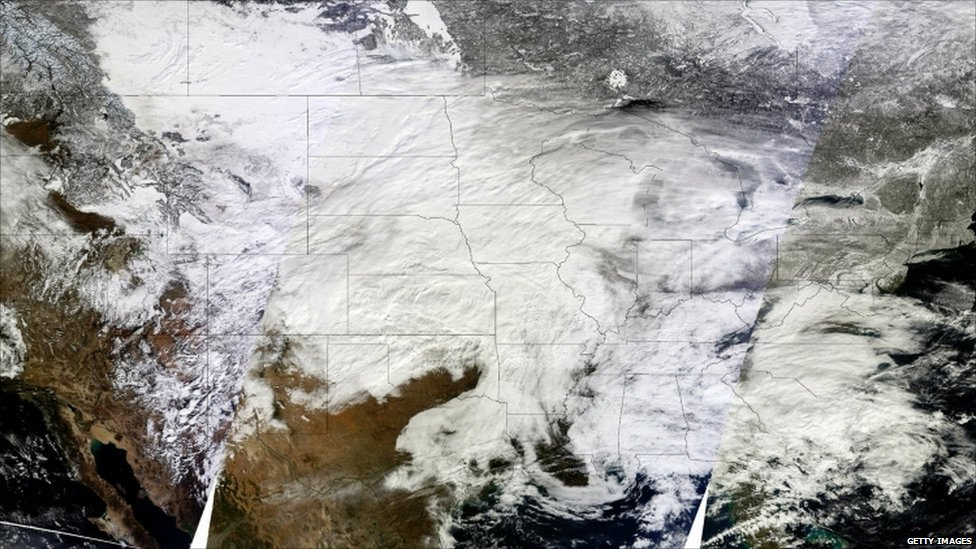 Three images from the Moderate Resolution Imaging Spectroradiometer (MODIS) aboard Nasa's Terra satellite were combined to create this image of the storm system
