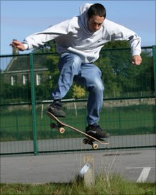 skateboarding vicar does a jump