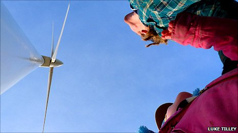 People looking up at Hockerton's wind turbine. Photo Luke Tilley