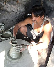 A potter making Chai cups