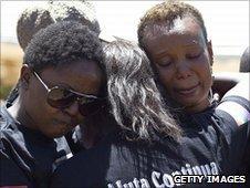 Members of the Ugandan gay community mourn