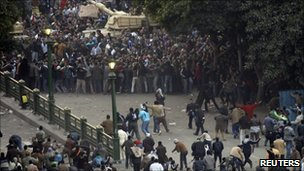 Supporters and opponents of Egypt&#039;s President Hosni Mubarak clash in Cairo&#039;s Tahrir Square - 2 February 2011