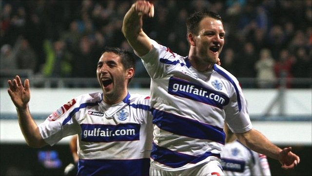 QPR's Tommy Smith and Clint Hill celebrate